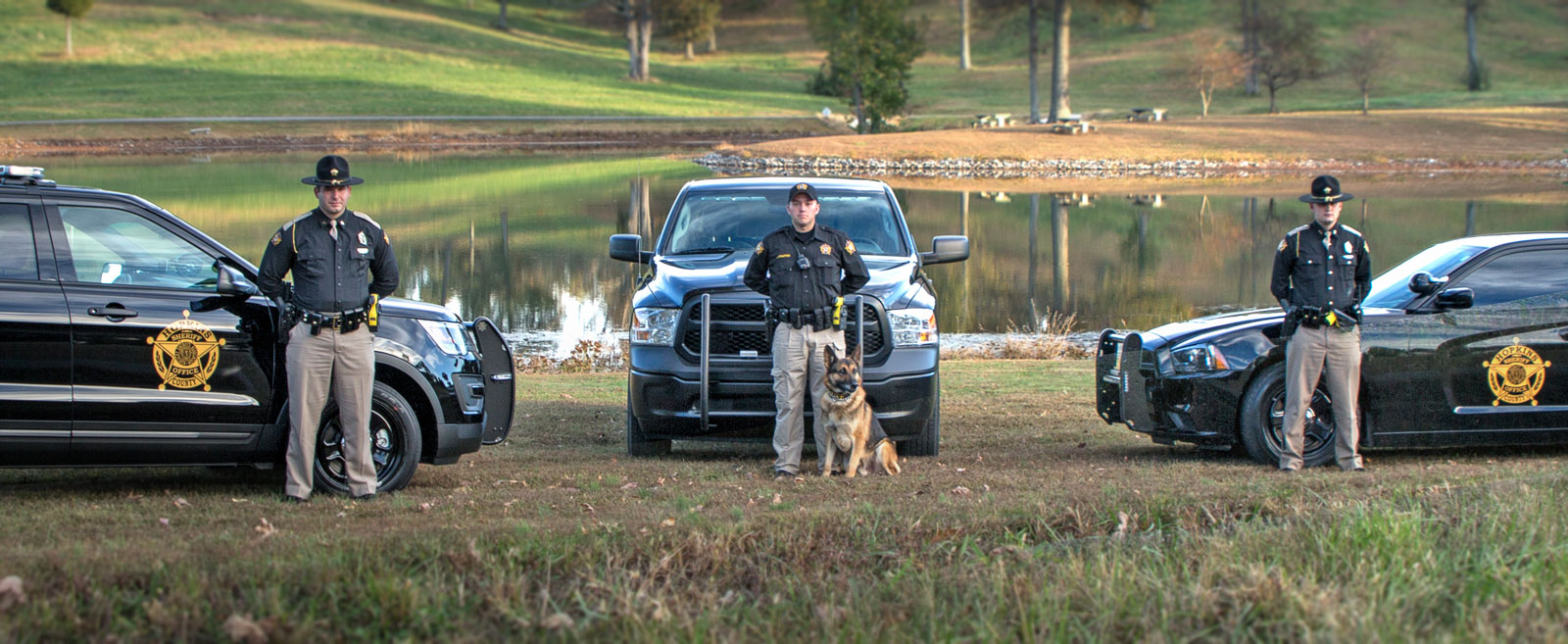 Photo with Vehicles, officers, and a k9